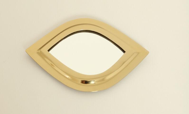 Petit miroir en forme d'œil doré